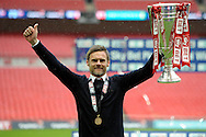 Fleetwood Town manager Graham Alexander celebrates as he  lifts the League Two Playoff Trophy.  Skybet football league two play off final match , Burton Albion v Fleetwood Town at Wembley Stadium in  London on Monday 26th May 2014.<br /> pic by John Patrick Fletcher, Andrew Orchard sports photography.