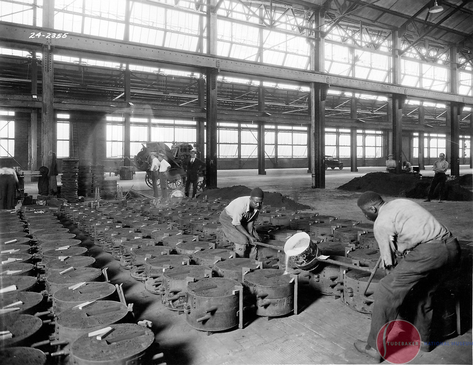 Studebaker foundry workers pour molten metal in this 1924 image.