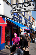 Street sign in Southall in West London, also known as 'Little India' by some, is an area almost completely populated by people from South Asia. Figures show that the area is approximately 50 percent Indian in origin although walking the streets it would appear far higher as the local people go about their shopping in the many shops specialising in goods specific to this culture. The mix of religions is mainly Sikh, Hindu and Muslim.<br /> <br /> Southall is primarily a South Asian residential district. 1950 was when the first group of South Asians arrived in Southall, reputedly recruited to work in a local factory owned by a former British Indian Army officer. This South Asian population grew due to the closeness of expanding employment opportunities. The most significant cultural group to settle in Southall are Indian Punjabis.