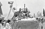 A convoy of Soviet soldiers arrive to cheering crowds after their arrival in Kabul from the eastern city of Jalalabad as the beginning of the Soviet withdrawal May 15, 1988 in Kabul Afghanistan.