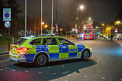© Licensed to London News Pictures. 05/12/2019. London, UK. A Metropolitan Police car parked on Grove Road as investigators inspect a London bus after a pedestrian - a woman in her 50's - was involved in a collision near the junction of Mile End Road. The woman was taken to an East London hospital in a serious condition. Photo credit: Peter Manning/LNP