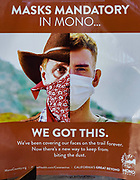 """""""Masks mandatory in Mono...we got this. We've been covering our faces on the trail forever. Now there's a new way to keep from biting the dust."""" Public health poster for the pandemic in Mono County, California, USA."""