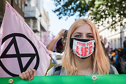A climate activist from Extinction Rebellion wears a Rebel for Life face covering on a march to a Back The Bill rally in Parliament Square from Buckingham Palace on 1st September 2020 in London, United Kingdom. Extinction Rebellion activists are attending a series of September Rebellion protests around the UK to call on politicians to back the Climate and Ecological Emergency Bill (CEE Bill) which requires, among other measures, a serious plan to deal with the UK's share of emissions and to halt critical rises in global temperatures and for ordinary people to be involved in future environmental planning by means of a Citizens' Assembly.