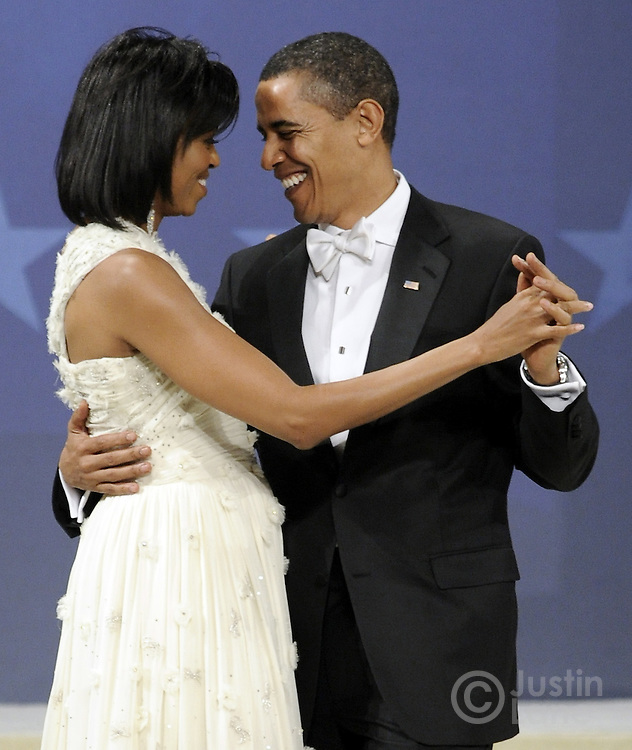 President Barack Obama (r) and first lady Michelle Obama dance during the Biden Home States Ball at the Washington Convention Center in Washington, DC, USA 20 January 2009. The ball is one of many Obama will attend over the course of the night, several hours after being sworn in as the 44th President of the United States.Barack H. Obama is sworn in as the 44th President of the United States during the 56th Presidential Inauguration ceremony on the steps of the U.S. Capitol Building in Washington, D.C., USA 20 January 2009. Obama defeated Republican candidate John McCain on Election Day 06 November 2008 to become the next U.S. President.