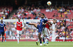 Memphis Depay of Lyon and Calum Chambers of Arsenal tussle for the ball - Mandatory by-line: Arron Gent/JMP - 28/07/2019 - FOOTBALL - Emirates Stadium - London, England - Arsenal v Olympique Lyonnais - Emirates Cup