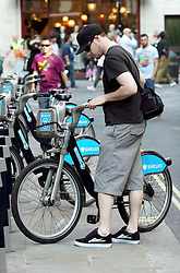 22 April 2011. London, England..Bikes for hire. A great way for tourists and locals to get about. Public bicycles for hire on the streets. It's cheap and easy to pick up a bike from numerous racks throughout the city where the bicycle can be taken away, cycled anywhere one wants and can be returned to any rack..Photo; Charlie Varley.
