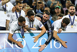 Players of Real Madrid celebrate during Trophy ceremony after winning during the football match between Real Madrid (ESP) and Atlético de Madrid (ESP) in Final of UEFA Champions League 2016, on May 28, 2016 in San Siro Stadium, Milan, Italy. Photo by Vid Ponikvar / Sportida