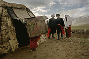 "The groom (white turban), his elder sister (white veil) and the wedding organizer (black hat), walk slowly one step at a time, to the yurt where the bride and groom will spend their first night. After each step taken, they wave the red cloth in their hand, saying ""Tulkulututum Pogolotchutun"", which, in Kyrgyz, means ""Congratulation for your wedding"".<br /> <br /> The Kyrgyz wedding ceremony of Koormoochoo Saïra (son of Yunus Amid) in Utch Djelgha summer camp, 5th August 20005.<br /> <br /> Adventure through the Afghan Pamir mountains, among the Afghan Kyrgyz and into Pakistan's Karakoram mountains. July/August 2005. Afghanistan / Pakistan."