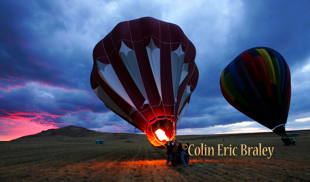 Storm clouds glow from the setting sun as balloonists make a last second attempt to go aloft at Antelope Island State Park in Utah. Colin Braley
