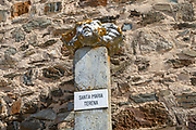 Ancient marble sculpture of Saint Mary, Santa Maria, aged with orange shield lichen resting one pedestal at the village of Terena, Alentejo Central, Portugal, Southern Europe