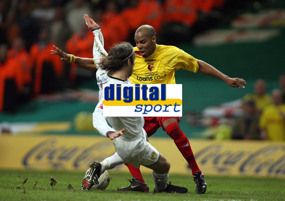 Photo: Rich Eaton.<br /> <br /> Leeds United v Watford. Coca Cola Championship. Play off Final. 21/05/2006.<br /> <br /> Marlon King is bought down in the box by Shaun Derry and Watford get a penalty