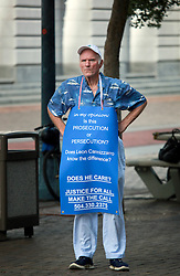 09 July 2014. New Orleans, Louisiana. <br /> Prosecution or persecution? A man with a statement on his chest outside Federal Court at the trial of Ray Nagin.   Former mayor of New Orleans is sentenced to serve 10 years in prison for bribery and money laundering. <br /> Photo; Charlie Varley/varleypix.com