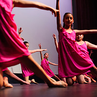 053014       Cable Hoover<br /> <br /> Students from the intermediate modern dance class perform together during the Foundations of Freefom World of Dance recital at El Morro Theatre in Gallup Friday.