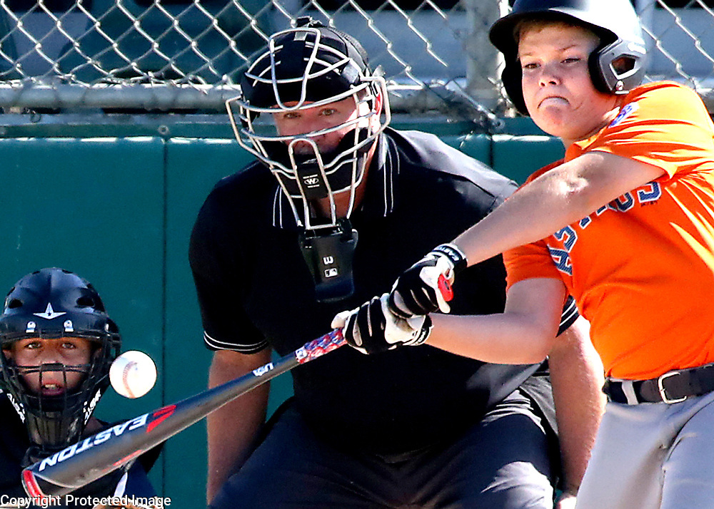 Santa Cruz American's Ron Esche makes solid contact at the plate during the opening game of the District 39 Little League Majors Tournament of Champions at Franich Park in Watsonville, California on Tuesday June 12, 2018. Santa Cruz lost the 18-16 high scoring affair to the Pajaro Valley Padres.<br /> Photo by Shmuel Thaler <br /> shmuel_thaler@yahoo.com www.shmuelthaler.com