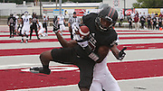 Lindenwood-Belleville RB Harvey Binford (15) leaps high for a catch to make the first touchdown of the game -- and the first touchdown in Lindenwood-Belleville history with this catch in the first half.  He was pressured by Avila DB Isiah Bryant (19, behind Binford).