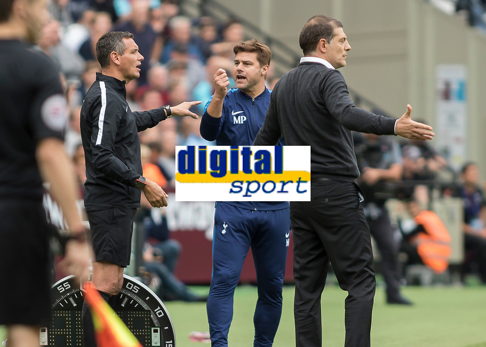 Football - 2017 / 2018 Premier League - West Ham United vs Tottenham Hotspur<br /> <br /> Mauricio Pochettino, Manager of Tottenham FC, brandishes an imaginery yellow card to Fourth Official Andre Marriner to show how he feels about a decision at the London Stadium<br /> <br /> COLORSPORT/DANIEL BEARHAM