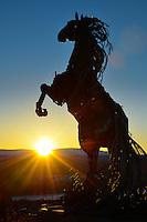 Whitehorse, Yukon, metal sculpture horse in sunrise