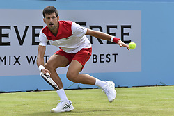 June 19, 2018 - London, England, United Kingdom - Novak Djokovic of Serbia plays a backhand during his match against John Millman of Australia on Day Two of the Fever-Tree Championships at Queens Club on June 19, 2018 in London, United Kingdom. (Credit Image: © Alberto Pezzali/NurPhoto via ZUMA Press)