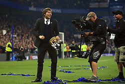 15 May 2017 - Premier League - Chelsea v Watford - Antonio Conte manager of Chelsea celebrates clutching an inflatable crown as the TV cameras look on - Photo: Marc Atkins / Offside.