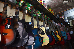 June 22, 2017 - Lahore, Punjab, Pakistan - Pakistani shopkeeper arranging their musical instruments during World Music Day. World Music Day is being celebrated globally on today for music lovers. The 'Fete de la Musique' (World Music day) is a day of free events to celebrate the universal language of music conceptualized in 1976 by American musician Joel Cohen. It was first celebrated in Paris in the year 1982. (Credit Image: © Rana Sajid Hussain/Pacific Press via ZUMA Wire)