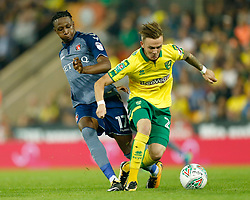 Charlton Athletic's Joe Aribo and Norwich City's James Maddison battle for the ball