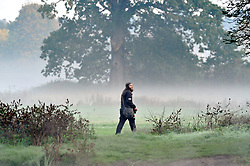 © Licensed to London News Pictures 20/10/2018<br /> SIDCUP,UK.<br /> Early morning photographer looking for a picture.<br /> A cold autumnal mist at Footscray Meadows this morning in Sidcup.<br /> Photo credit: Grant Falvey/LNP