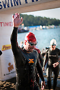 Brad Miller of Fairview, NC waves to the screaming crowds coming around the first turnaround on the beach in Sunday's Ford Ironman competition...