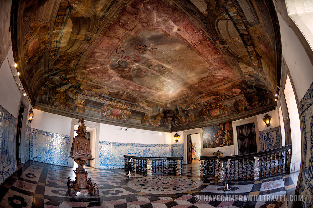 LISBON, Portugal - The Monastery's entrance hall is ornately decorated in the 18th century Baroque style, with the ceiling painted by Vicenzo Baccarelli (1682-1745), an Italian painter who introduced the trompe l'oeil style to Portugal. The Monastery of São Vicente de Fora is a 17th-century church and monastery in the Alfama neighborhood of Lisbon. It features ornately decorated sections in the Baroque style as well as the Braganza Pantheon, where the kings who ruled Portugal between 1640 and 1910 are interred.