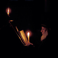 Israel, Jerusalem, Coptic Christian priest reads from Bible in Church of Holy Sepulcher during Holy Week
