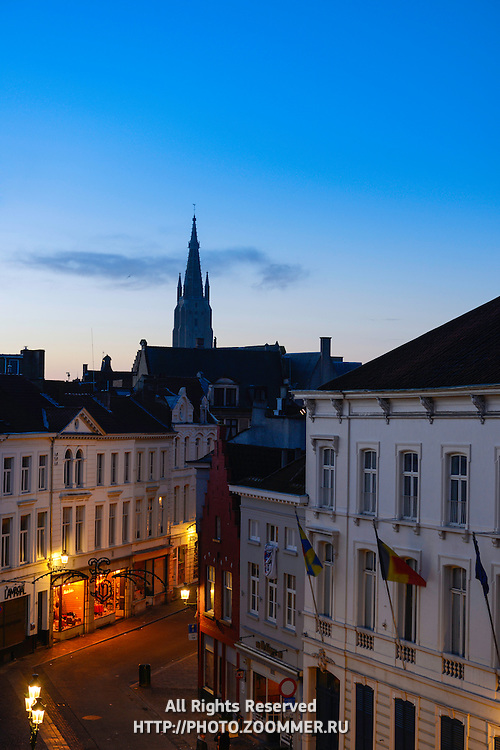 Brugge Street At Night With Church Of Our Lady At Distance