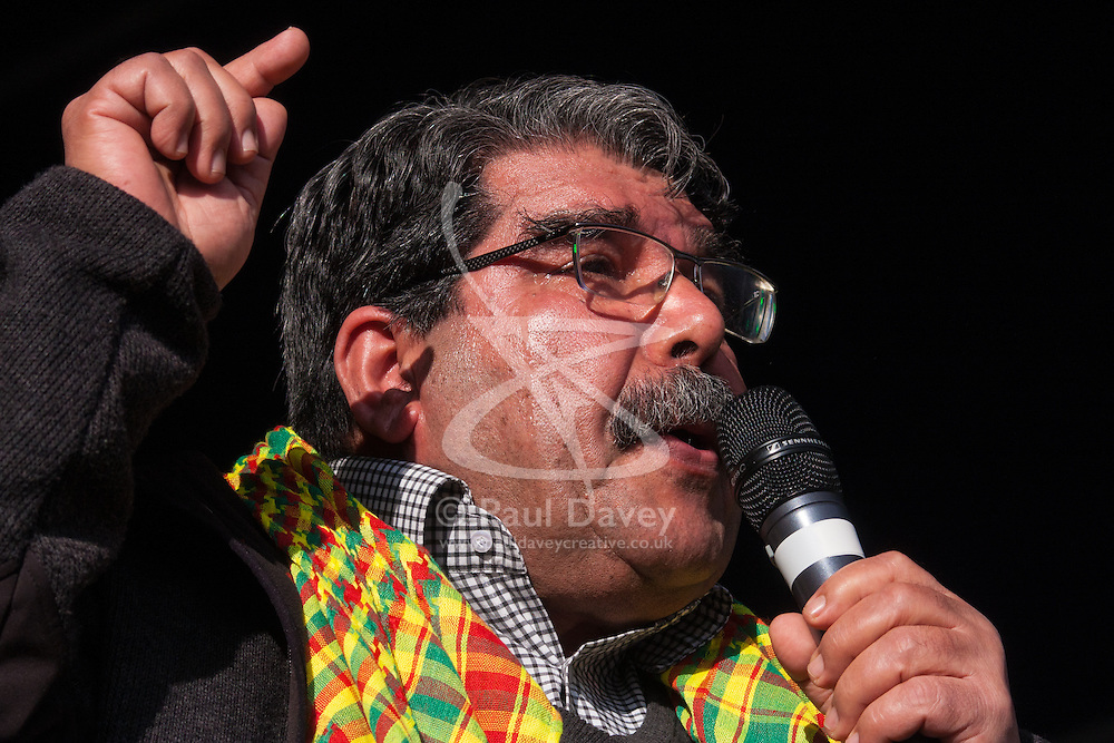 Finsbury Park, London, March 22 2015. Thousands of London's Kurdish community gather for Newroz, their traditional New year's celebrations. The exiled community mourns the death of Londoner and ex Royal Marine Konstandinos Erik Scurfield, a hero to them, who was killed fighting ISIS, and whose mother Vasiliki Scurfield addressed the crowd.PICTURED: Co-Chair of the Kurdish PYD party Saleh Muslim, tears streaming down his face, relates to the crowd how he lost his son in the fight against ISIS.