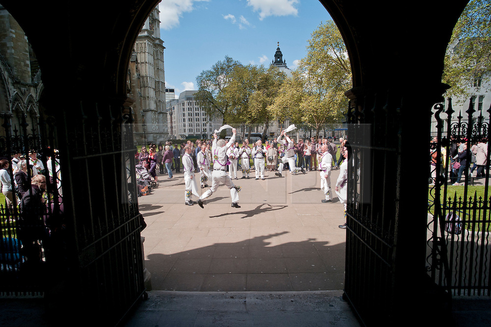 © Licensed to London News Pictures. 12/05/2012, London, UK.  East Surrey Morris Men dance outside the Westminster Abbey in London as Morris men from around the country gather in London for a Westminster Morris Men Day of Dance, Saturday, May 12, 2012. Photo credit : Sang Tan/LNP