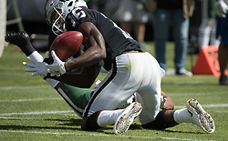 September 17, 2017 - Raiders vs. Jets.Oakland Raiders wide receiver Johnny Holton (16) recovers a dropped kick reception by New York Jets wide receiver Kalif Raymond (84) in the 2nd half at Oakland Alameda County Stadium on Sunday, Sept. 17, 2017 in Oakland, CA (Credit Image: © Paul Kuroda via ZUMA Wire)