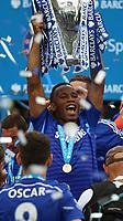 Football - 2014 / 2015 Premier League - Chelsea vs. Sunderland.   <br /> <br /> Chelsea's Didier Drogba lifts the Premier League trophy at Stamford Bridge <br /> <br /> COLORSPORT/DANIEL BEARHAM