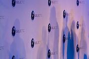 Virgin Galactic logos backdrop and executives' silhouettes during company space tourism presentation at Farnborough airshow.