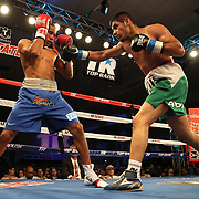 ORLANDO, FL - OCTOBER 04:  Felix Verdejo of Puerto Rico (L) and Sergio Villanueva of Mexico (R) trade punches during their professional lightweight boxing match at the Bahía Shriners Auditorium & Events Center on October 4, 2014 in Orlando, Florida. Verdejo won by a TKO in the third round. (Photo by Alex Menendez/Getty Images) *** Local Caption *** Felix Verdejo; Sergio Villanueva