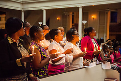 Nursing alumni light candles along with the graduating class.  Ten graduates of the University of the Virgin Islands School of Nursing commemorated their graduation with a pinning ceremony and lighting of candles while surrounded by nursing alumni, family, and friends.  University of the Virgin Islands School of Nursing 2015 Pinning Ceremony.  St. Thomas Reformed Church.  St. Thomas, VI.  12 May 2015.  © Aisha-Zakiya Boyd