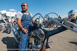 Aki Sakamoto at the Rat's Hole bike show at the Buffalo Chip Campground during the 75th Annual Sturgis Black Hills Motorcycle Rally.  SD, USA.  August 6, 2015.  Photography ©2015 Michael Lichter.