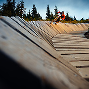 Rex Flake rides a wood feature along the single track trails of Steven's Pass Resort near Leavenworth, Washington.