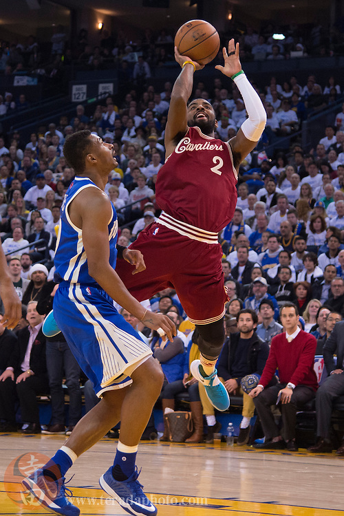 December 25, 2015; Oakland, CA, USA; Cleveland Cavaliers guard Kyrie Irving (2) shoots the basketball against Golden State Warriors guard Leandro Barbosa (19) during the second quarter in a NBA basketball game on Christmas at Oracle Arena. The Warriors defeated the Cavaliers 89-83.