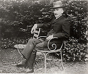 Henri Bergson (1859-1941) French philosopher, sitting in his garden.