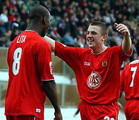 Photo: Daniel Hambury.<br /> Milton Keynes Dons V Bristol City.<br /> Coca Cola League One.<br /> 09/04/2005.<br /> Bristol City's Scott Brown celebrates with two goal hero Leroy Lita.