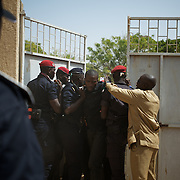 February 26, 2012 - Dakar, Senegal: Senegalese police try to control a crowd who tried to attack president and candidate, Abdoulaye Wade, while voting at the Franco-Arab School in Point E area of Dakar. Hundreds of people queueing for voting insulted and heckled Wade, accusing the head of state of disrespect for the country's constitution when running for a third mandate. (Paulo Nunes dos Santos/Polaris)