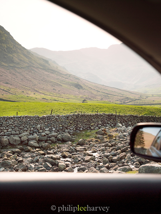 Hills and countryside with old stone walls in the Lake District, UK
