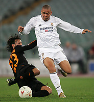 Roma 5/12/2004 Champions League Group B<br /> <br /> Roma Real Madrid 0-3 <br /> <br /> Real Madrid's Ronaldo moves the ball upfield past AS Roma's Alberto Aquilani tries to tackle him <br /> <br /> Photo Andrea Staccioli Graffiti