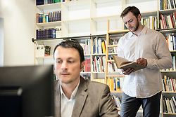Two businessmen working in an office, Bavaria, Germany