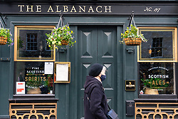 Edinburgh,Scotland, UK. 30 October 2020. With Edinburgh remaining in Tier 3 (Level 3) lockdown bars and restaurants remain severely restricted in business hours with many remaining closed and boarded up.  Pictured; The Albanach pub on the Royal Mile remains closed. Iain Masterton/Alamy Live News