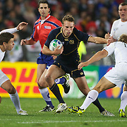 Mike Blair, Scotland, fends off Jonny Wilkinson, England, during the England V Scotland Pool B match during the IRB Rugby World Cup tournament. Eden Park, Auckland, New Zealand, 1st October 2011. Photo Tim Clayton...