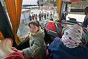 Nederland, Nijmegen,14-4-2016De noodopvang kamp Heumensoord loopt sinds begin maart langzaam leeg. Het COA brengt de asielzoekers elders onder om het tentenkamp op 1 mei leeg te hebben om met de afbraak te kunnen beginnen. 1 juni moet het terrein opgeleverd worden. Deze goep van 25 gaat naar Zeewolde. Iedereen mag twee koffers en wat handbagage meenemen. Fietsen moeten achterblijven of worden later opgehaald, hoewel sommige kinderen hun fietsje mogen meenemen. Vertrekkende bewoners nemen soms emotioneel afscheid van vrijwilligers en achterblijvers. In de afgelopen maanden zijn vele vriendschappen ontstaan. Foto: Flip Franssen