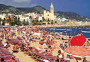 SPAIN, CATALONIA, COSTA DORADA SITGES; fashionable seaside resort south of Barcelona; Church of Sant Bartomeu above the beach and the sea